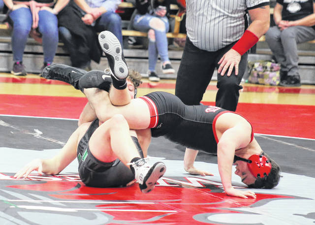 Point Pleasant junior Derek Raike locks in a hold on a Winfield opponent during a 145-pound match on Wednesday night during a 2021 season opening quad held in Point Pleasant, W.Va.