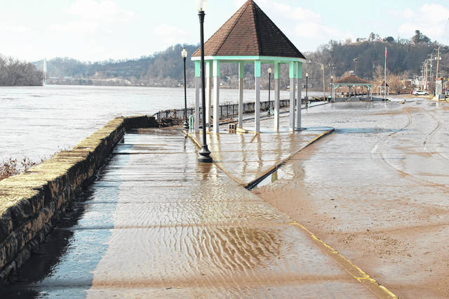 With the Ohio River receding what remains is the mud, debris and other items. On Thursday morning, the Pomeroy Parking Lot was clear of water, other than in the dip by the amphitheater, but the mud and debris remained.