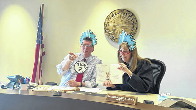 """In celebration of the birthday of Dr. Seuss, Judge Margaret Evans of the Gallia County Common Pleas Court and Gallia Prosecutor Jason Holdren, pictured, entertained all Hannan Trace Elementary School students with a reading of """"Mr. Brown Can MOO! Can You?"""" via Zoom this week. """"We are thankful for the opportunity to connect with the youth of Gallia County,"""" read a statement on Holdren's Facebook page where the entire reading of the classic book can be viewed. (Courtesy)"""