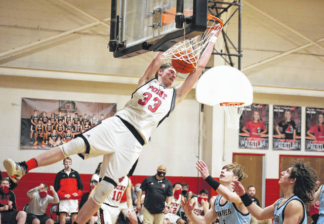 Point Pleasant center Eric Chapman (33) slams down a dunk in the fourth quarter of the Big Blacks' season-opening 82-77 setback on Friday in Point Pleasant, W.Va.