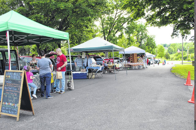 Raised Around Rio, a farmers and artisan market, is set to return in May for the season. Pictured from a previous year is an evening at the market held on North College Avenue in Rio Grande, Ohio. (OVP File Photo)
