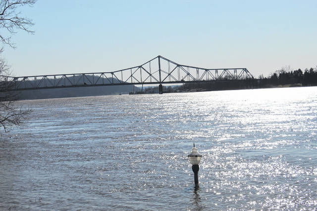 This lone light pole emerges from the Ohio River at Point Pleasant's Riverfront Park with the Silver Memorial Bridge in the distance. (Beth Sergent | OVP)