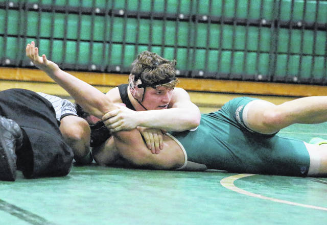 River Valley junior Will Hash tries to complete a pinfall win during a 152-pound match against Athens on Jan. 15, 2020, at Athens High School in The Plains, Ohio.