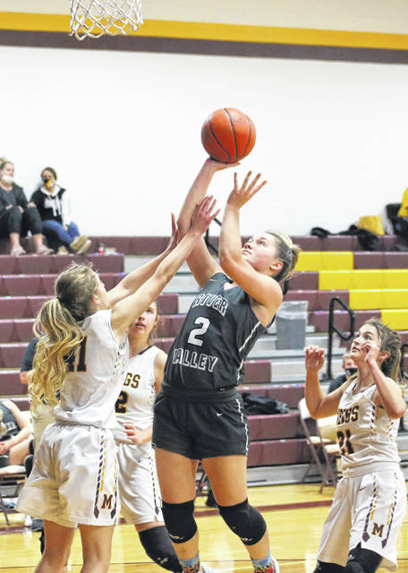 River Valley senior Hannah Jacks (2) releases a shot attempt over a Meigs defender during a Dec. 21, 2020, girls basketball contest at Larry R. Morrison Gymnasium in Rocksprings, Ohio.
