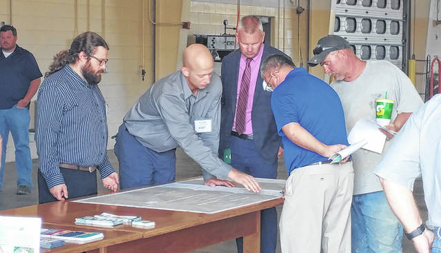 Pictured are Ohio Department of Transportation officials discussing Ohio 7 rehabilitation plans with area residents and officials back in 2019 in Gallia County. (OVP File Photo)