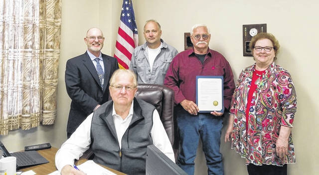 Pictured seated is Gallia County Commissioner Harold G. Montgomery; pictured standing, from left, are Gallila County Department of Job and Family Services Director Dana Glassburn, Commissioner Q. Jay Stapleton, Commissioner M. Eugene Greene and Educational Service Center – OCSE Superintendent Denise Shockley. (Gallia County Commission | Courtesy)