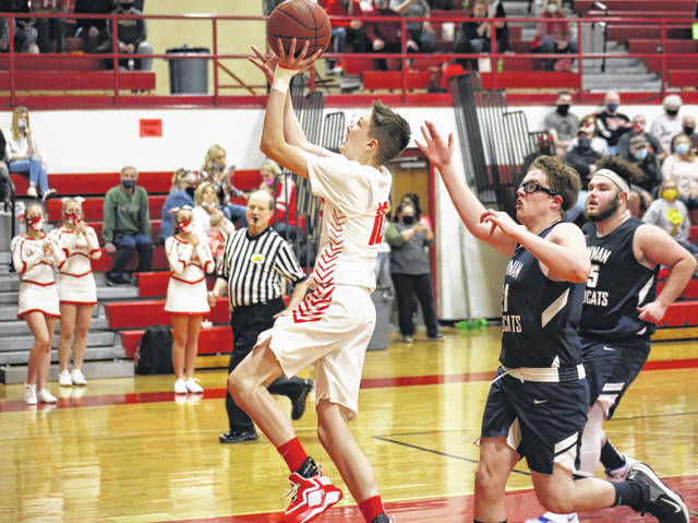 Wahama freshman Alex Hardwick finishes a fast break with a layup, during the White Falcons' March 20 victory over Hannan on Gary Clark Court in Mason, W.Va.