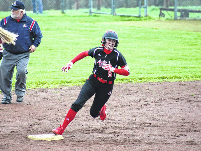 Point Pleasant's Hayley Keefer rounds second and heads for third during the Lady Knights' season-opening victory on April 12 in Rocksprings, Ohio.