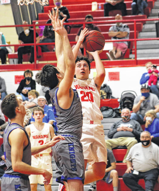 WHS senior Isaac Roush (20) shoots a two-pointer during the first half of the White Falcons' 64-48 setback on March 16 in Mason, W.Va.