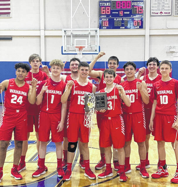 Members of the Wahama boys basketball team pose for a photo following the Class A Region 2, Section 1 Championship victory on Friday in Glenville, W.Va.