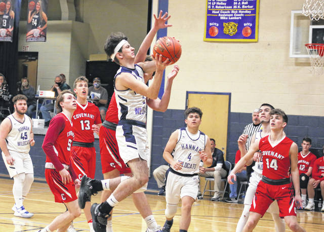 Hannan sophomore Dakota Watkins releases a shot attempt over a Covenant defender during the first half of Thursday night's boys basketball contest in Ashton, W.Va.