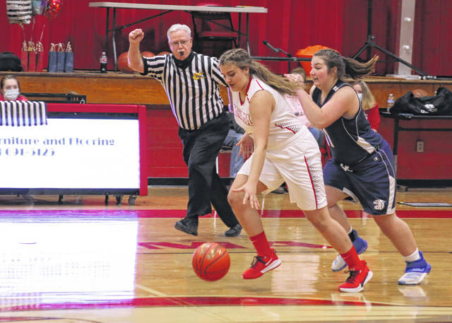 Wahama sophomore Morgan Christian is fouled by Hannan defender Makenzie Simmons during the first half of Friday night's girls basketball contest in Mason, W.Va.