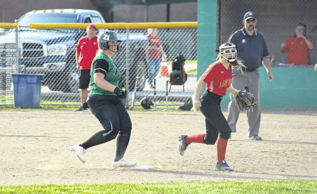 Eastern's Kelsey Roberts (21) pulls into second base behind South Gallia's Payten Halley (5), during the Lady Eagles' 9-0 victory on Monday in Tuppers Plains, Ohio.