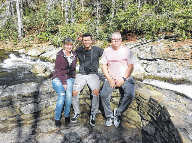 """Connor Christian (center), a Gallipolis, Ohio native, is currently competing on """"The Voice,"""" which airs on NBC on Monday nights. Christian is pictured with his parents, Randy and Tina."""