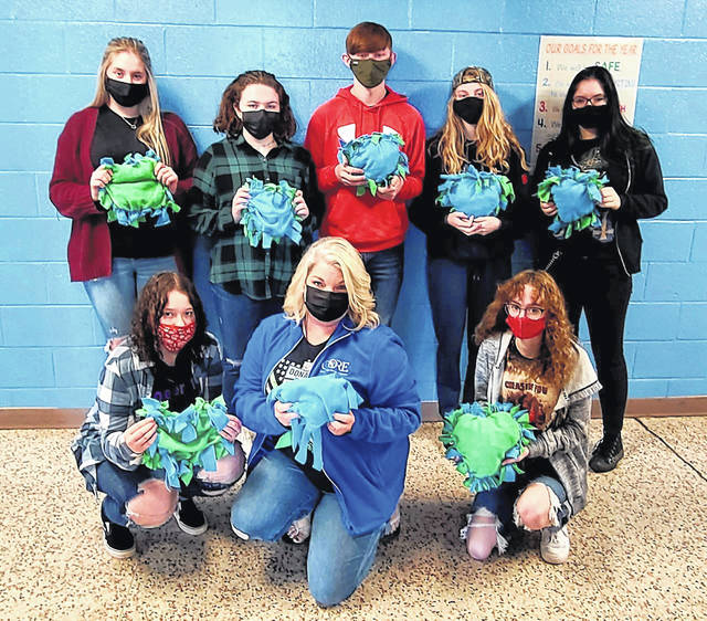 Brandy Barkey Sweeney, pictured front row at center with her students from the Careers in Education course at the Mason County Career Center (MCCC). Students made no-sew pillows to be sent to the University of Pittsburgh Medical Center for transplant recipients.