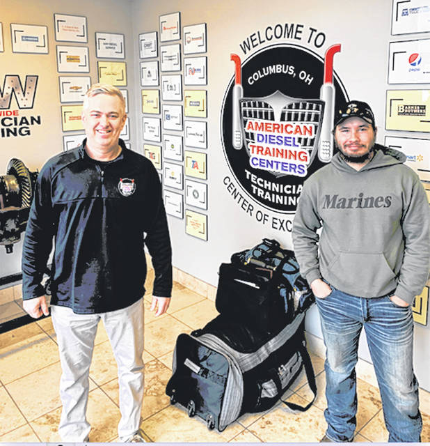 Tim Spurlock is pictured with Dustin Bickers, a fellow Gallia County native, who recently completed the program at American Diesel Training Centers.