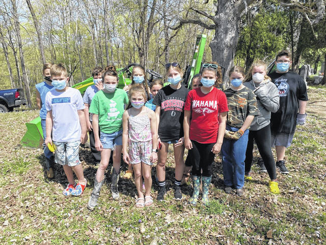 Members of the Sugar Maple 4-H Club, with Sally Smith as leader, are pictured following a recent clean-up of the Odd Fellows Cemetery near Mason. The club gathered to clear the graveyard of limbs and brush prior to mowing season. (Mindy Kearns | Courtesy)