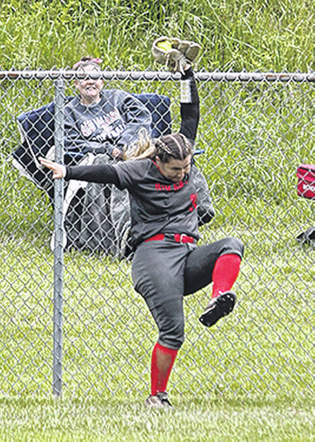 Rio Grande freshman Cierra Clark robs Indiana University Southeast of a home run during Saturday's championship first final between the two schools in the River States Conference Softball Championship at Jackson Memorial Park in Vienna, W.Va. The Plain City, Ohio native hit a tie-breaking home run in the bottom of the sixth inning of the winner-take-all second final to give the RedStorm a 6-5 win over the Grenadiers.