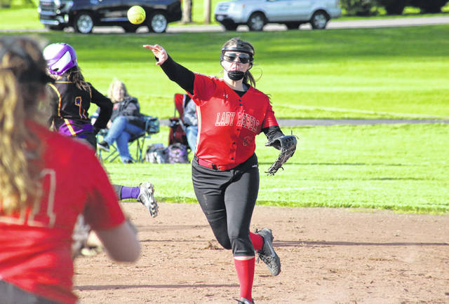 South Gallia junior Jessie Rutt throws to first base, during the second game of the Lady Rebels' double-header on Tuesday in Racine, Ohio.