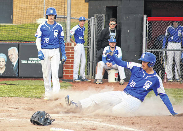 Gallia Academy junior Zane Loveday (20) slides safely into home during the first inning of a May 11 baseball game against Point Pleasant in Point Pleasant, W.Va.