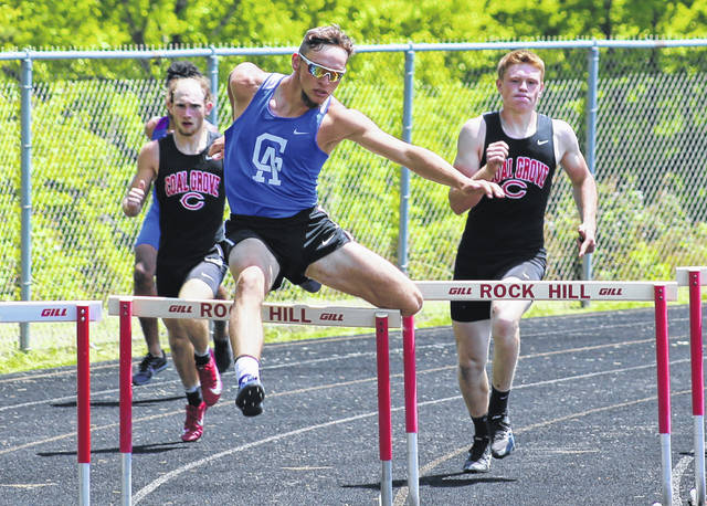 Gallia Academy senior Tristin Crisenbery clears an obstacle in the 300m hurdles event held Saturday during the OVC Championships at Rock Hill High School in Pedro, Ohio.