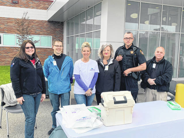 Pictured from left, Courtney Midkiff, Meigs County Health Department; Neil Creasey, Holzer Pharmacy; Angie Stowers, ADAMHS; Gwen Craft, Holzer Community Outreach; Deputy Rick Smith, Meigs County Sheriff's Office; and Wayne Wollard, Holzer Security.