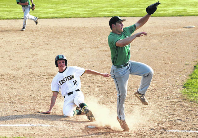 Eastern senior Conner Ridenour (10) slides into third base behind Waterford's Dylan Taylor, during the Eagles' 11-3 victory on Tuesday in Tuppers Plains, Ohio.