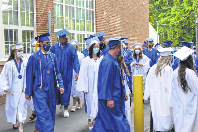 Members of the Gallia Academy Class of 2021 department Washington Elementary and descend into Memorial Field for Friday's commencement ceremony.