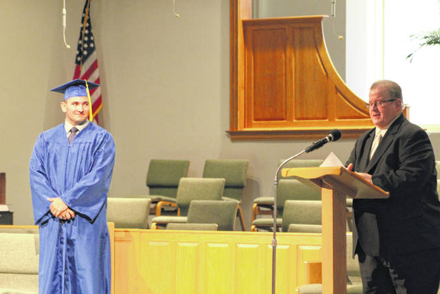 Patrick D. Taylor, at left, is the lone member of the Ohio Valley Christian School Class of 2021. Also pictured, is OVCS Administrator Patrick O'Donnell at this week's commencement.