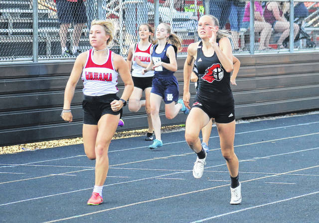 Wahama's Lacey Neal (left) and Point Pleasant's Elicia Wood (right) lead the way in the 100m dash, during a quad meet on Tuesday in Point Pleasant, W.Va.
