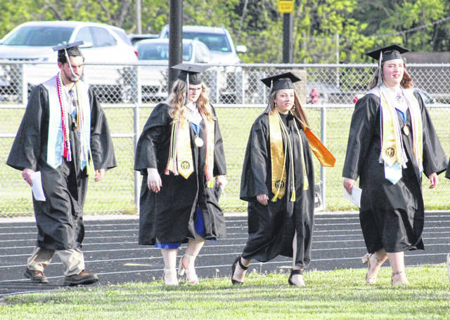 River Valley graduates, led by Class President Kristen Clark, enter the field for Friday evening's commencement ceremony.