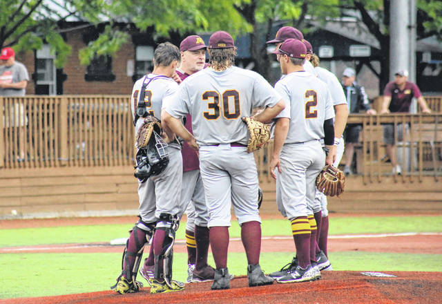 Marauders head coach Jeff Wayland makes a visit to the mound, during the Division III district final on Wednesday in Chillicothe, Ohio.