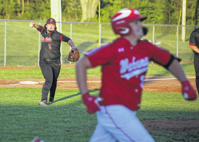 Point Pleasant third baseman Tanner Mitchell, left, releases a throw to first to record an out during an April 26 baseball game against Wahama in Point Pleasant, W.Va.