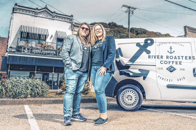 River Roasters Coffee Company owners Candice and Larry Hess Jr. are pictured in front of the café in Pomeroy.