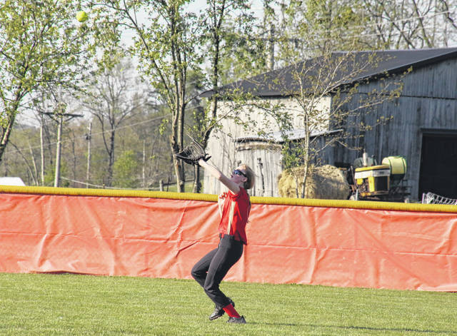South Gallia's Dafney Clary settles under a flyball, during the Lady Rebels' April 27 loss to Eastern in Mercerville, Ohio.