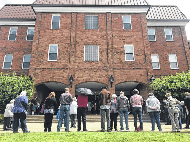 Many residents assembled outside the Gallia County Courthouse on Thursday for a local observance of the National Day of Prayer.