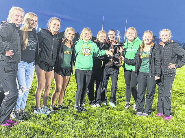 Members of the Eastern girls track and field team pose for a picture after winning the 2021 TVC Hocking title on Wednesday night at South Gallia High School in Mercerville, Ohio.