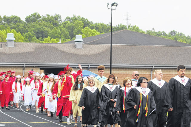 Faculty lead the South Gallia High School Class of 2021 to their seats during Saturday's commencement.