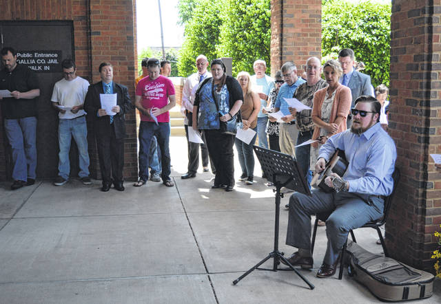 Gallia residents sing at the Gallia Courthouse during a previous National Day of Prayer observance, prior to the pandemic. Rick Jackson led the crowd in songs.
