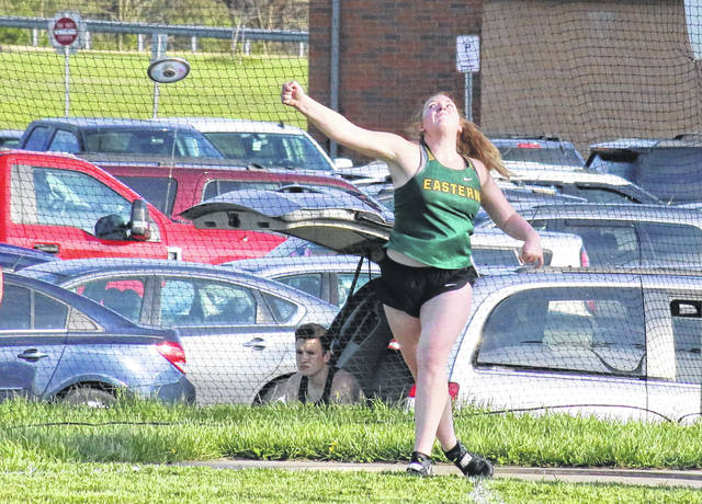 Eastern senior Layna Catlett releases an attempt in the discus event during an April 13 meet at Meigs High School in Rocksprings, Ohio.