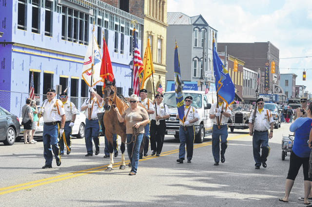 """The Gallipolis Memorial Day Parade steps off at 10:30 a.m., May 31. All veteran service organizations, businesses, foundations and other community support groups are invited to participate in the parade. Individuals or groups interested in participating in the Memorial Day Parade are asked to please contact the Gallia County Veterans Service Office at 740-446-2005 no later than Friday, May 21. Following the parade will be a ceremony featuring guest speaker and Medal of Honor recipient, Hershel """"Woody"""" Williams. Williams will also be the parade's grand marshal. Pictured is the VFW 4464 Honor Guard presenting the colors at at previous Memorial Day Parade."""