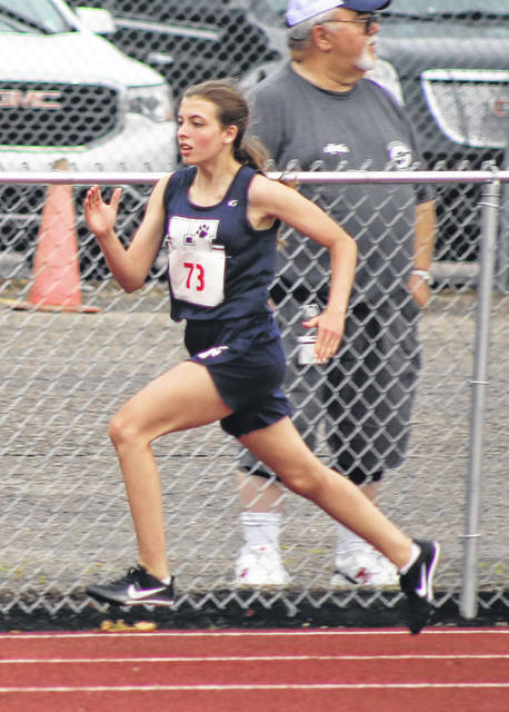 Hannan freshman Miranda Smith hits full stride during the first heat of the 400m dash finals Wednesday night at the 2021 Class A track and field championships held at Laidley Field in Charleston, W.Va.