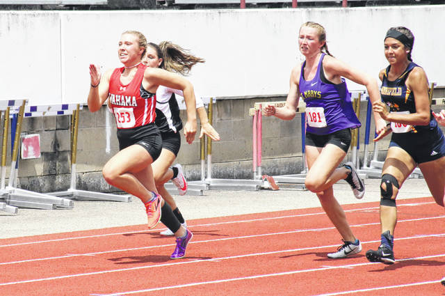 Wahama junior Lacey Neal (253) leads a trio of competitors in the Class A 100m dash prelim on Thursday at Laidley Field in Charleston, W.Va. (Alex Hawley|OVP Sports)