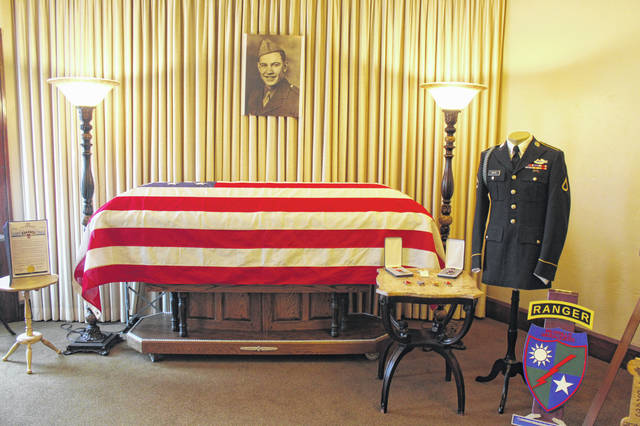 The flag draped casket of Army Pfc. James Wilmer White sits in Ewing-Schwarzel Funeral Home in advance of services on Saturday.