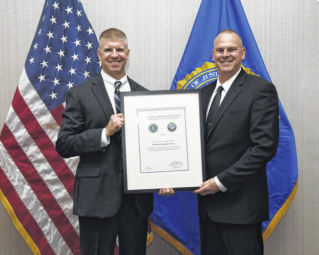 Gallia Sheriff Matt Champlin, at right, recently completed the FBI's inaugural session of its National Command Course in Stafford, Va. Also pictured, Todd Bobe, supervisory special agent.