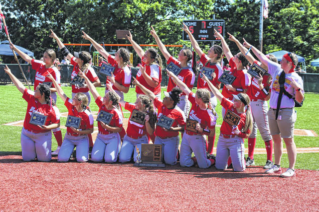 Members of the Wahama softball team pose for photos following their 5-3 victory in the Class A state championship on Wednesday at Little Creek Park in South Charleston, W.Va.
