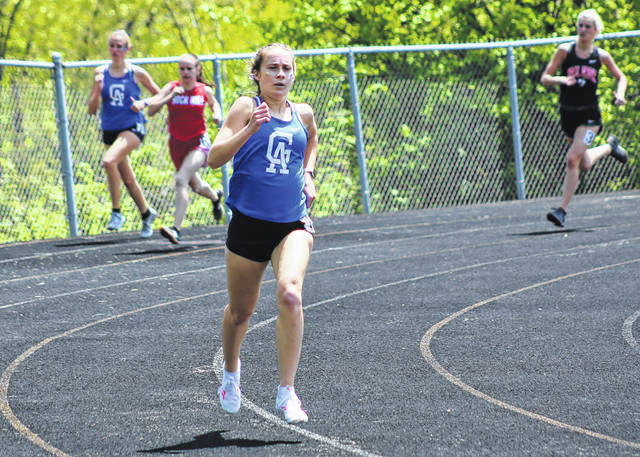 Gallia Academy senior Sarah Watts leads the field around the turn during the 800m run at the 2021 Ohio Valley Conference Championships held May 15 at Rock Hill High School in Pedro, Ohio.