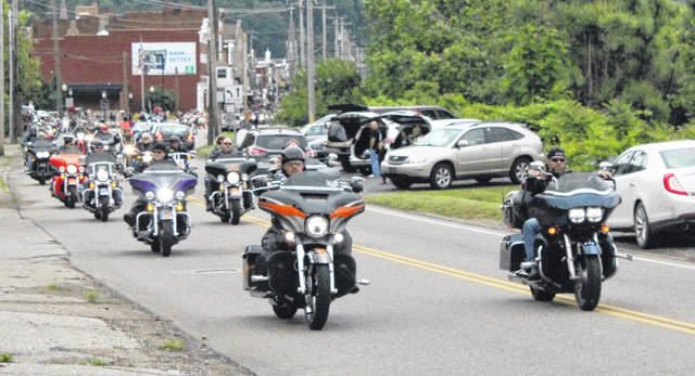 Bikers leave the Pomeroy Parking Lot for the Memorial Run.