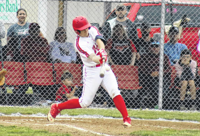 Wahama junior Ethyn Barnitz blasts a grand slam, during the first inning of the White Falcons' 11-10 victory on Wednesday in Mason, W.Va.