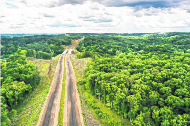 This photo provided by the West Virginia of Transportation shows an aerial view of a portion of the 14.6 miles of upgraded road along U.S. 35 between Mason and Putnam counties.